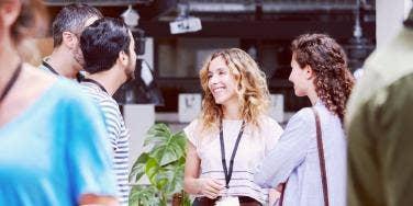 happy company employees talking