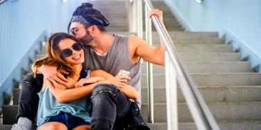 man kissing a woman on the stairs