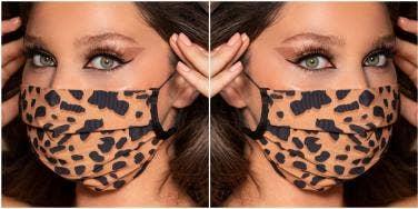 woman with big eyes and false eyelashes wearing a face mask