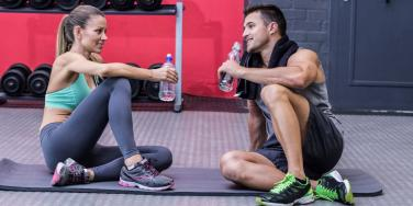 man and woman at the gym talking