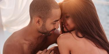 shirtless couple being intimate