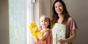 mom and toddler doing chores