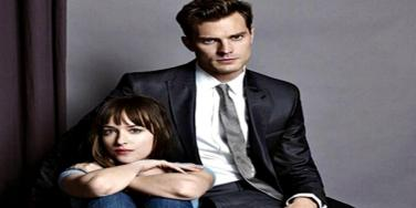 Dakota Johnson as Ana Steele and Jamie Dornan as Christian Grey for 'Fifty Shades Of Grey,' the '50 Shades Of Grey' movie, in Entertainment Weekly