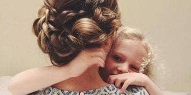 mom & daughter hugging