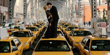 couple kissing on cab