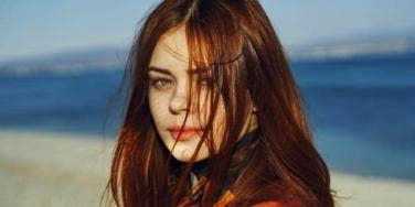 redhead woman on beach
