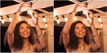 woman turning on a light bulb