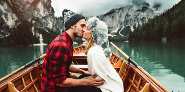 couple kissing on a boat