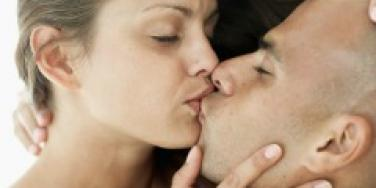 Couple Kissing with eyes closed