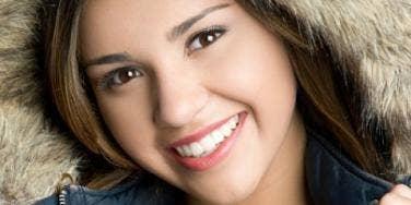 Smiling Latina woman wearing winter parka
