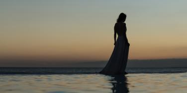 woman walking by water