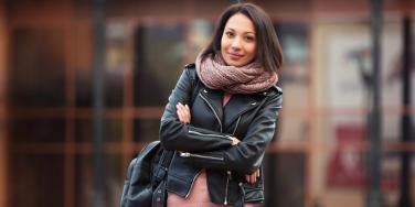 smiling woman wearing leather jacket