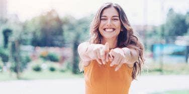 happy woman wearing an orange shirt