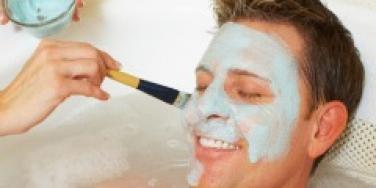 man getting facial at spa