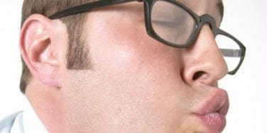 Man smooching face