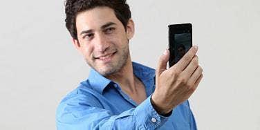 man takes selfie