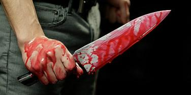 man with bloody knife