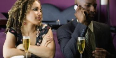 Man on cell during date