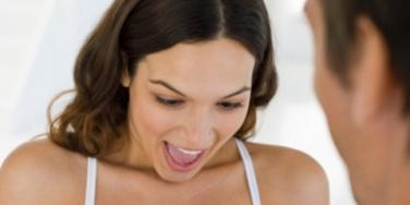 man proposing woman happy engaged