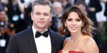 Matt Damon in tux, Luciana Barroso in a red strapless dress