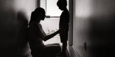 mom punishing child black and white