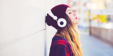 woman listening to sad songs about lost love
