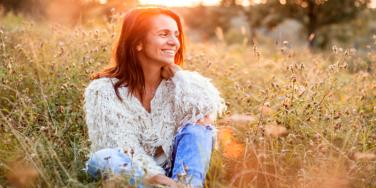 woman smiling in a field