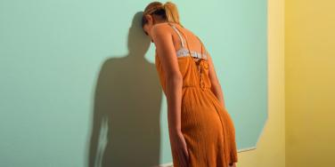 woman leaning against wall