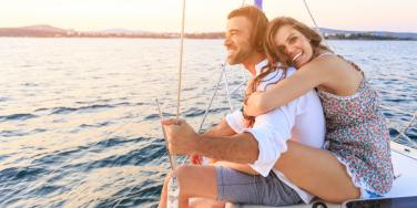 happy man and woman on a boat