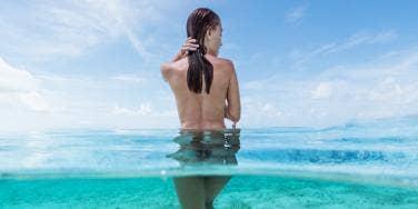nude woman in ocean