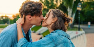 man and woman about to kiss outside