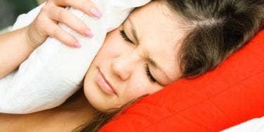 pillows over ears