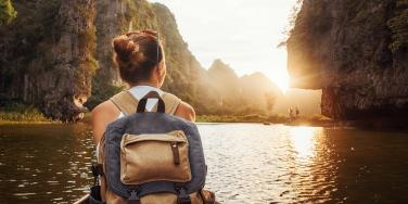 woman backpacking at sunset