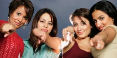 Women pointing outward