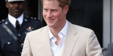 Prince Harry smiling tan suit