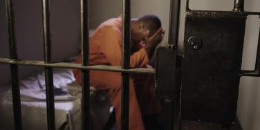 prison inmate in cell