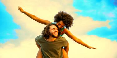 guy giving his girlfriend a piggyback ride
