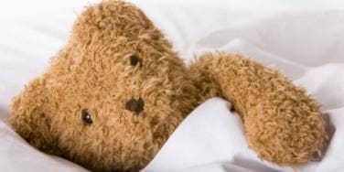 teddy bear in bed
