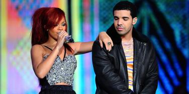 The Secret Meaning Behind Rihanna And Drake's Matching Tattoos