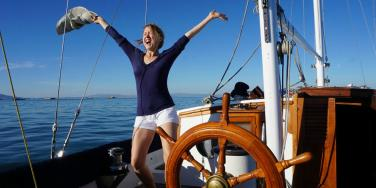 author on a sailboat