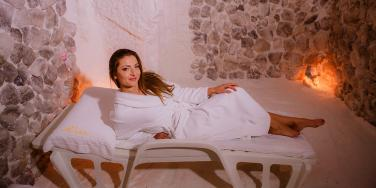 woman lounging in salt room