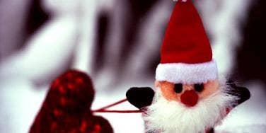 mini santa carrying a heart