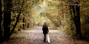 woman walking away from the past