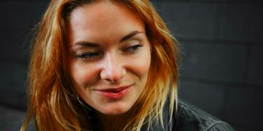woman smiling and thinking