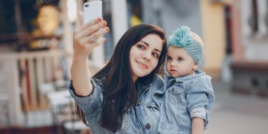 mom taking selfie with baby