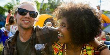 biracial couple outside smiling