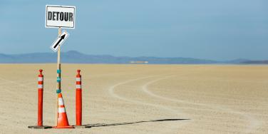 detour sign in the sand