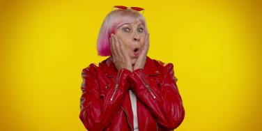 shocked stylish older woman