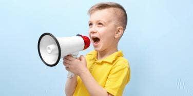 boy yelling through megaphone