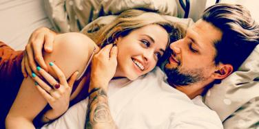 man and woman laying together